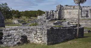 The Mayan ruins in the Tulum complex 2. Remains of ancient temples and buildings dating back to the Mayan civilization in Tulum, Mexico royalty free stock photo