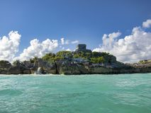 Mayan ruins of Tulum - Mexico. January 28, 2014, Quintana Roo, Mexico - A general view of the Mayan archaeological ruins of Tulum is seen from a boat royalty free stock image