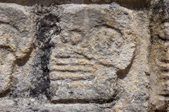 Mayan Stone Carvings. Stone carvings of faces on the side of a platform in the Mayan site of Chichen Itza stock photos