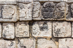 Mayan Stone Carvings. Stone carvings of faces on the side of a platform in the Mayan site of Chichen Itza royalty free stock photos