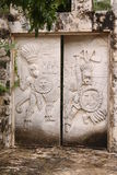Mayan Stone Gate. Stone Gate crafted in Mayan Style in Playa del Carmen. Mayan warriors Royalty Free Stock Photography
