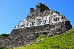 Mayan Temple Ruins at Xunantunich. Mayan Temple Ruins of El Castillo or the Stone Lady at Xunantunich in Belize, Latin America against a bright blue sky Stock Photography