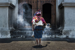 Mayan woman performing a ritual in front of the Santo Tomás church in the town of Chichicastenango, in Guatemala Royalty Free Stock Photography