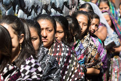 Mayan women carrying a float during easter procession Royalty Free Stock Photos