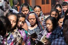 Mayan women in Guatemala. March 25, 2016 San Pedro la Laguna, Guatemala: praying women dressed in traditional Mayan clothing at Easter celebration Stock Images