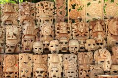 Mayan wood mask rows Mexico handcraft faces. Indian culture Royalty Free Stock Images