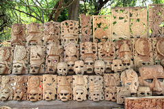 Mayan wood mask rows Mexico handcraft faces Stock Images