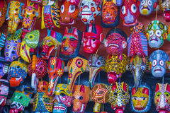 Mayan wooden masks. For sale at Chichicastenango market in Guatemala Royalty Free Stock Photography