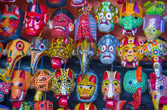 Mayan wooden masks. For sale at Chichicastenango market in Guatemala Stock Images
