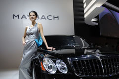 Maybach 62s and model Royalty Free Stock Image