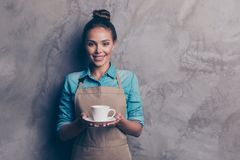 Maybe you want a cup of coffee Girl holding a drink stretching stock photos