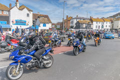 Mayday Festivities. Motorbikes ride through Hastings Old Town to meet with the thousands of bikes that arrive on this day of celebration every year Stock Photo