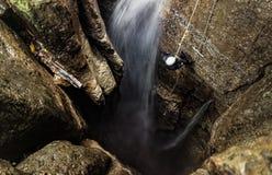 Mayei Cave Deep Entrance Shaft. Speleologist Inside Of Mayei Cave Waterfall Entrance Shaft In Ecuadorian Amazonia Stock Photo