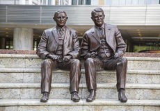 Mayo Clinic brothers william charles statue. Bronze statues sculpture at Mayo medical clinic in Rochester Minnesota sitting Charlie and William Mayo brothers Royalty Free Stock Image