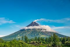 Mayon Vocalno in Legazpi, Philippines. Mayon Volcano or Mount Mayon, is an active stratovolcano in the province of Albay in Bicol Region, on the large island of Stock Images
