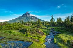 Mayon Vocalno in Legazpi, Philippines. Mayon Volcano or Mount Mayon, is an active stratovolcano in the province of Albay in Bicol Region, on the large island of Royalty Free Stock Images