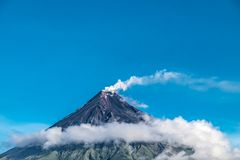 Mayon Vocalno in Legazpi, Philippines. Mayon Volcano or Mount Mayon, is an active stratovolcano in the province of Albay in Bicol Region, on the large island of Royalty Free Stock Photo