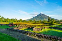 Mayon Vocalno in Legazpi, Philippines. Mayon Volcano or Mount Mayon, is an active stratovolcano in the province of Albay in Bicol Region, on the large island of Royalty Free Stock Photos