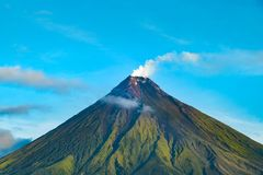 Mayon Vocalno in Legazpi, Philippines. Mayon Volcano or Mount Mayon, is an active stratovolcano in the province of Albay in Bicol Region, on the large island of Stock Photo