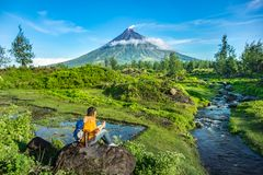 Mayon Vocalno in Legazpi, Philippines. Mayon Volcano or Mount Mayon, is an active stratovolcano in the province of Albay in Bicol Region, on the large island of Stock Photos