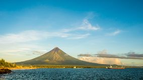 Mayon Volcano is an active stratovolcano in the province of Albay in Bicol Region, on the island of Luzon in the. Philippines. Renowned as the perfect cone stock image