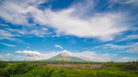 Mayon Volcano is an active stratovolcano in the province of Albay in Bicol Region, on the island of Luzon in the. Philippines. Renowned as the perfect cone royalty free stock images