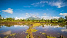 Mayon Volcano is an active stratovolcano in the province of Albay in Bicol Region, on the island of Luzon in the. Philippines. Renowned as the perfect cone royalty free stock photos