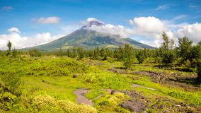 Mayon Volcano is an active stratovolcano in the province of Albay in Bicol Region, on the island of Luzon in the. Philippines. Renowned as the perfect cone royalty free stock photography