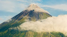 Mayon Volcano is an active stratovolcano in the province of Albay in Bicol Region, on the island of Luzon in the. Philippines. Renowned as the perfect cone stock photos