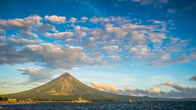 Mayon Volcano is an active stratovolcano in the province of Albay in Bicol Region, on the island of Luzon in the. Philippines. Renowned as the perfect cone stock photography