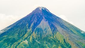 Mayon Volcano is an active stratovolcano in the province of Albay in Bicol Region, on the island of Luzon in the. Philippines. Renowned as the perfect cone royalty free stock image