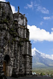 Mayon Volcano Behind a Church. Mayon Volcano Peak from behind an old Church in Legaspi, Southern Luzon, Philippines Royalty Free Stock Photos