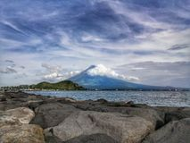 Mayon volcano; disastrous beauty. A perfect cone shaped of Mayon volcano in Albay, Philippines Stock Images