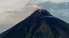 Mayon Volcano in Legazpi, Philippines. Mayon Volcano is an active volcano and rising 2462 meters from the shores of the. Gulf of Albay stock video footage