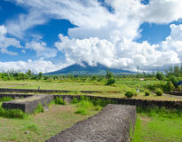 Mayon volcano in the philippines. Mayon is a classic stratovolcano (composite) type of volcano with a small central summit crater. The cone is considered the stock photography