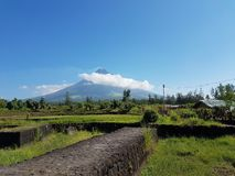 Mayon Volcano. View of Mayon Volcano in Cagsawa Ruins Church. The volcano is hiding from the clouds and people say that Mt. Volcano is a shy volcano but fierce stock image