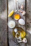 Mayonaise ingredients on rustic wood backgound. Copy space Royalty Free Stock Photo