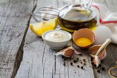Mayonaise ingredients on rustic wood backgound. Copy space Royalty Free Stock Photography