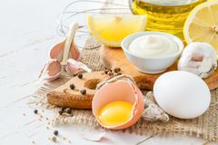 Mayonaise ingredients on white wood backgound. Copy space Royalty Free Stock Images