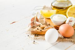 Mayonaise ingredients on white wood backgound. Copy space Stock Image