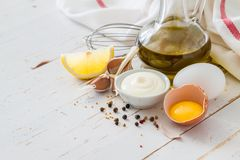 Mayonaise ingredients on white wood backgound. Copy space Stock Photos