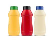 Mayonesa y mostaza de la salsa de tomate ningunas botellas del plástico de la etiqueta Imagen de archivo libre de regalías