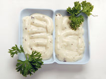 Mayonnaise. Two-set sauceboat with sauce and parsly flakes Royalty Free Stock Photo