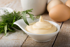 Mayonnaise in bowl on table Royalty Free Stock Images