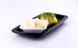 Mayonnaise with corn. Mayonnaise with babycorn and dill over black plate Stock Image