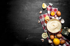 Mayonnaise with eggs , garlic, and lemon slices. Royalty Free Stock Photos