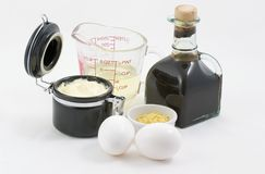 Mayonnaise with ingredients. Beautiful jar of mayonnaise along with the ingredients, oil, eggs, mustard, vinigar, that went into making this creation Stock Images
