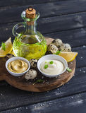 Mayonnaise and ingredients for cooking - olive oil, quail eggs. lemon, mustard and spices Royalty Free Stock Images