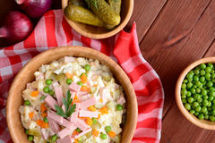 Mayonnaise salad with Bologna sausage, pea, onion, pickles and carrot Royalty Free Stock Photography