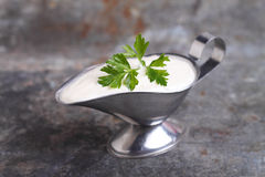 Mayonnaise sauce in a gravy boat gray Stock Images